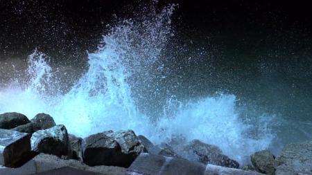 big-sea-waves-beating-against-the-coastal-rocks-big-splashes-of-the-ocean-waves-crashing-on-the-rocks_b47vqw9__F0006